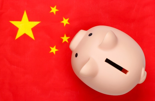 Piggy bank with the flag of china.