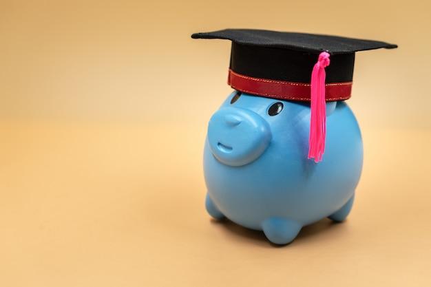 Piggy bank with a graduation cap.