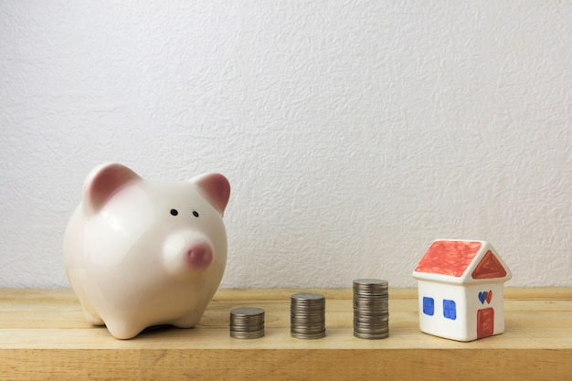 Piggy bank with house and coins