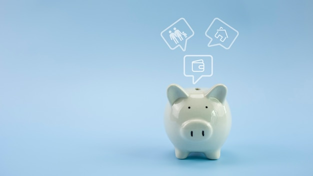 Piggy bank with icon on pastel blue background