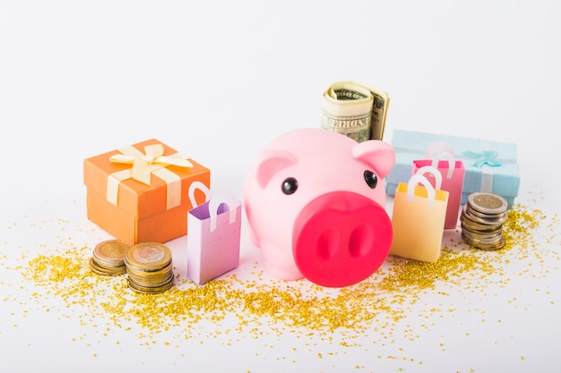 Piggy bank with money and gift boxes