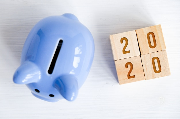 Piggy bank with numbers symbolizing new year