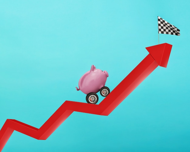 Piggy bank with wheel like a car runs wants to reach the flag. concept of fast increse of money.cyan background