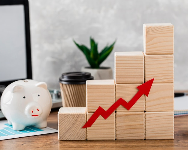 Piggy bank with wooden growth blocks