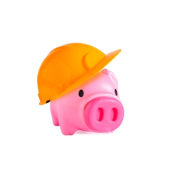 Piggy bank with yellow construction on background.