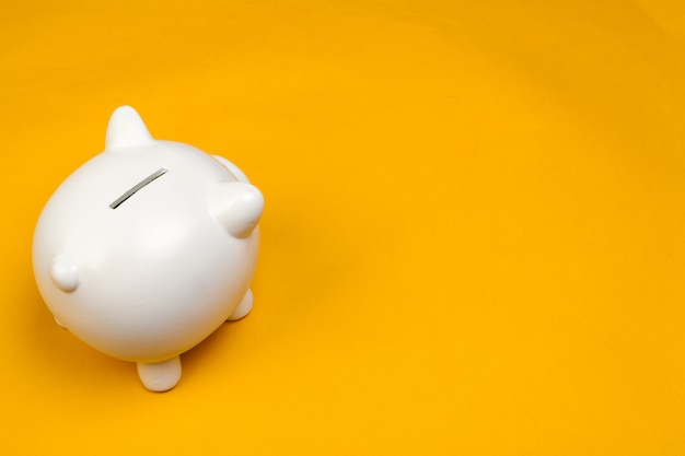 Piggy bank on yellow background