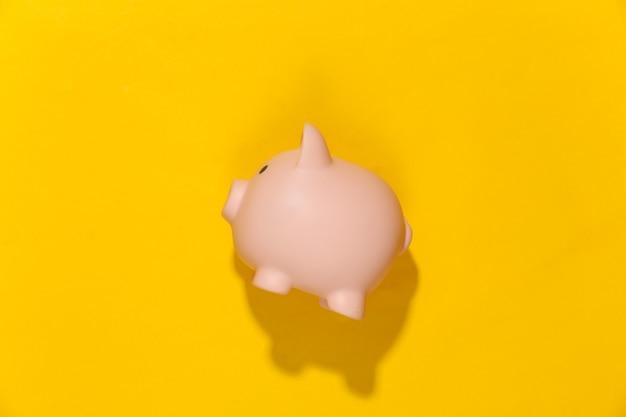 Piggy bank on yellow sunny bright.