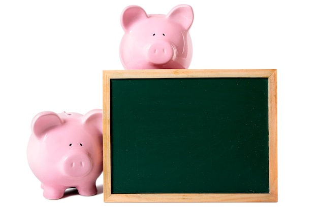 Piggy banks with blank blackboard