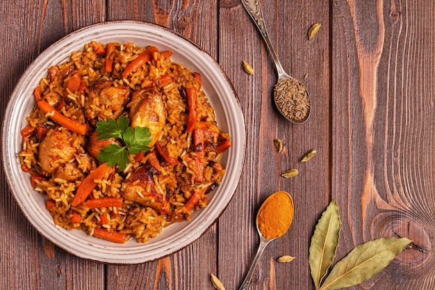 Pilaf (biryani) on a wooden background,, copy space.