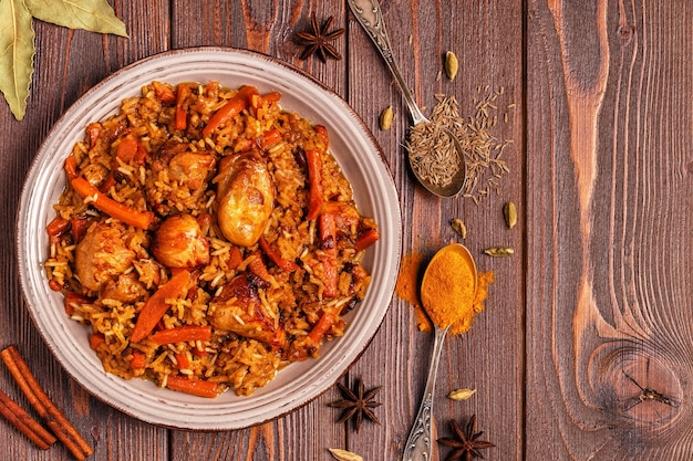 Pilaf (biryani) on a wooden, top view, copy space.
