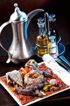 Плов - рис с бараниной и овощами. с салатом из лука и помидоров
