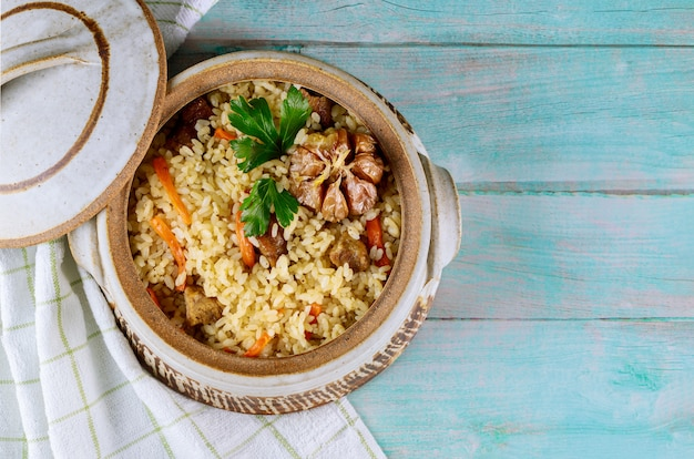 Pilaf with carrot, garlic and meat.
