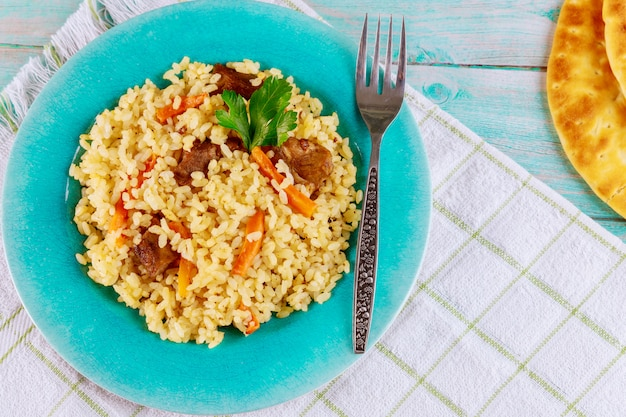 Pilaf with carrot, meat and garlic