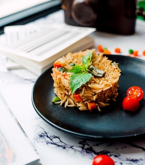 Pilaf with chopped vegetables and tomato