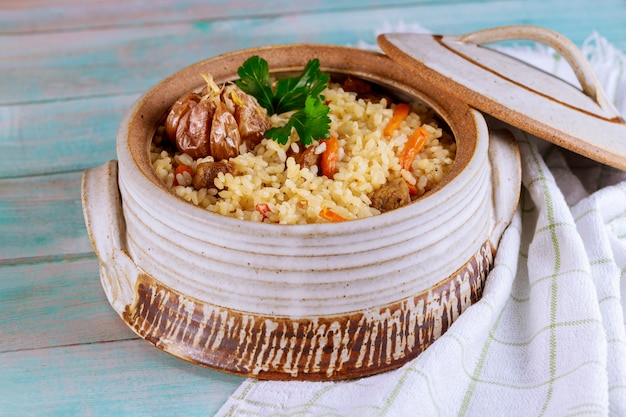 Pilaf with meat, carrot and garlic.