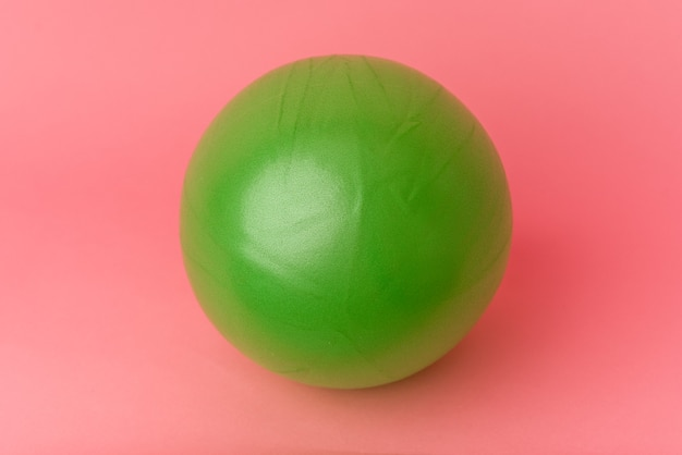 Pilates ball isolated on pink background