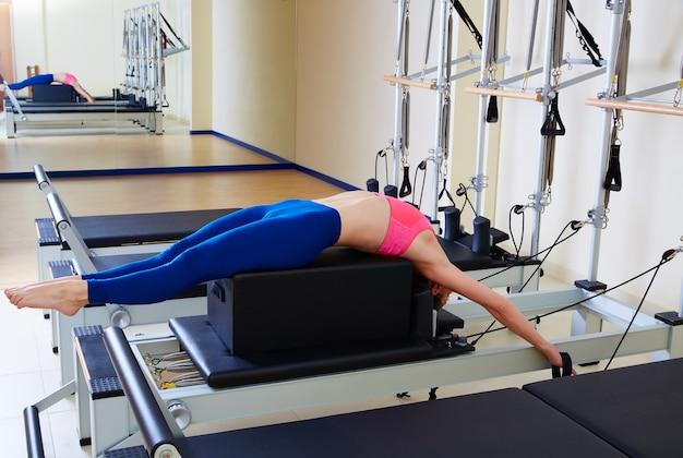 Pilates reformer woman back stroke exercise