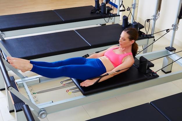Pilates reformer woman hundred exercise