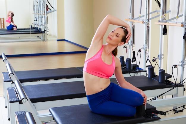 Pilates reformer woman mermaid exercise