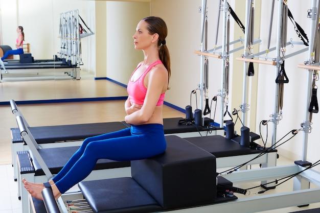 Pilates reformer woman short box exercise