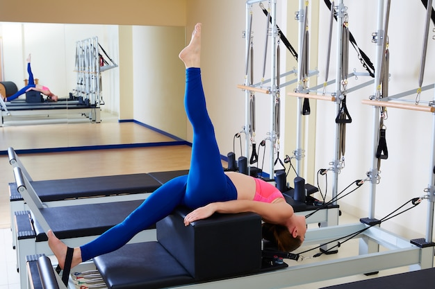 Pilates reformer woman short box tree exercise