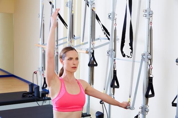 Pilates reformer woman side push through exercise