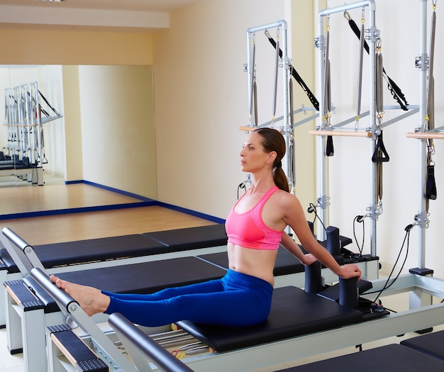 Pilates reformer woman stomach massage flat