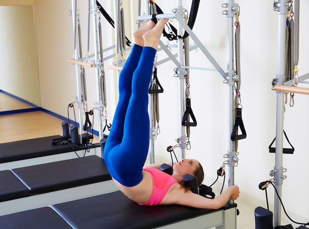 Pilates reformer woman tower exercise