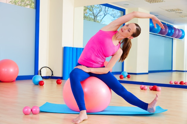 Pilates woman fitball swiss ball exercise workout
