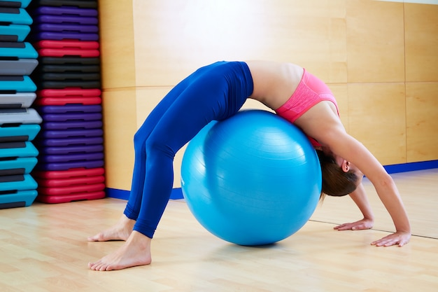 Pilates woman gymnastics bridge fitball exercise