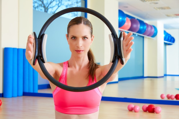 Pilates woman magic ring hands exercise