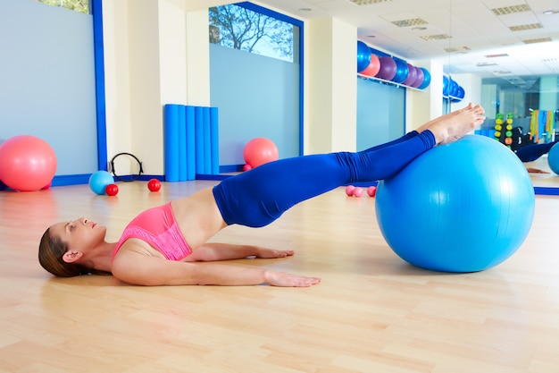 Pilates woman pelvic lift fitball exercise workout
