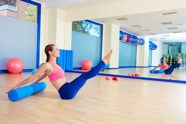 Pilates woman roller teaser roll exercise workout