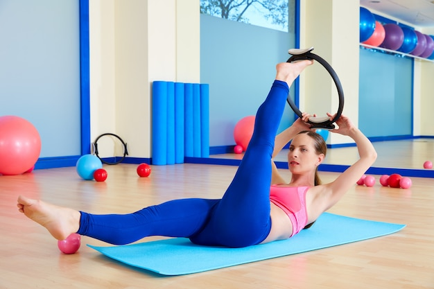 Pilates woman scissor magic ring exercise workout