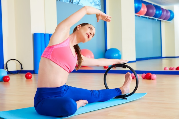 Pilates woman side stretch magic ring exercise