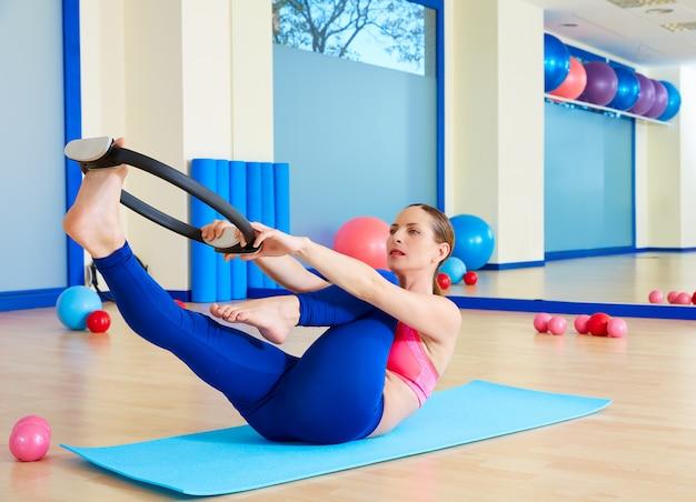 Pilates woman single leg stretch magic ring exercise
