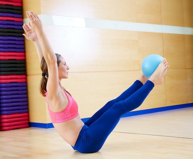 Pilates woman stability ball teaser exercise