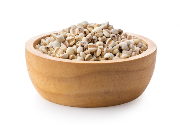 Pile of adlay millet in wood bowl on white