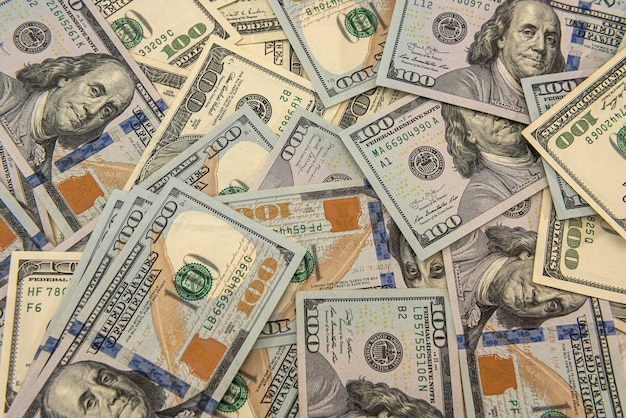 Pile of american dollar bills as financial background. business concept