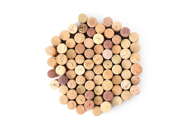 Pile of assorted used wine corks in shape of circle isolated on white background.