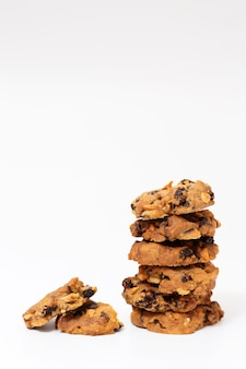 Pile of bakery cookies on white background.