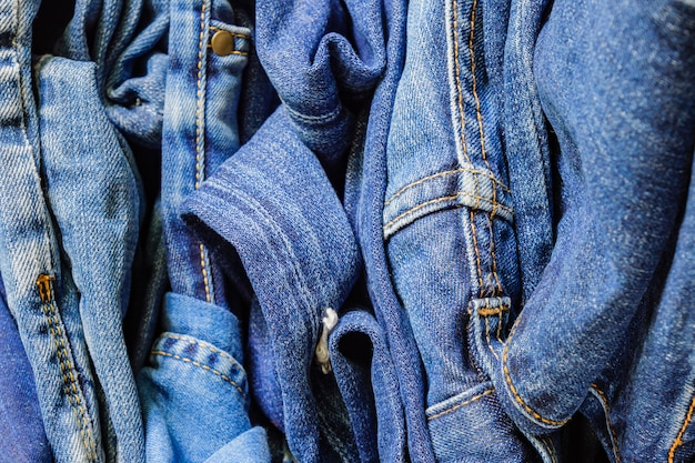 Pile of blue denim jeans. beauty and fashion concept.