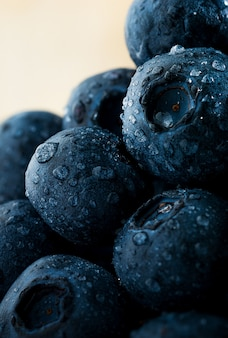 Pile of blueberries and dew drops macro picture background