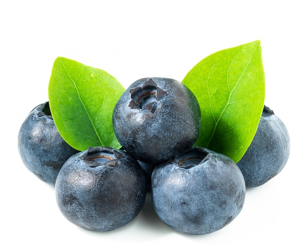 Pile of blueberries and leaves isolated on white background