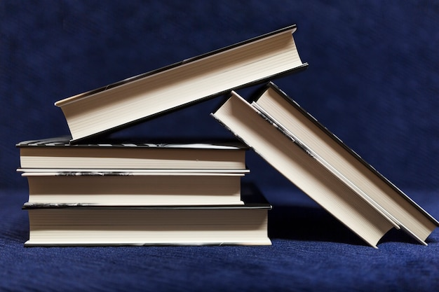 Pile of books on blue background