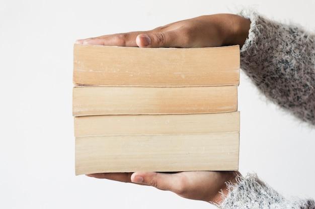 Pile of books between hands