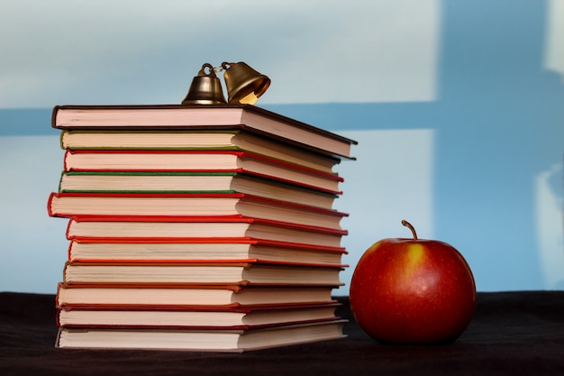 Pile of books with apple, education, reading, back to school concept