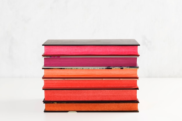 Pile of books with color stack on white table