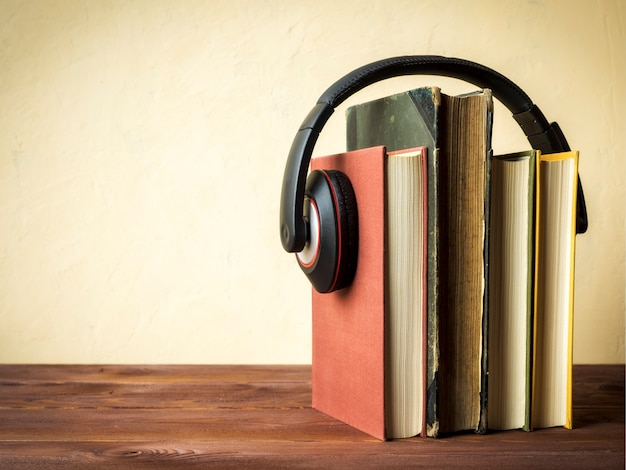 Pile of books with headphones