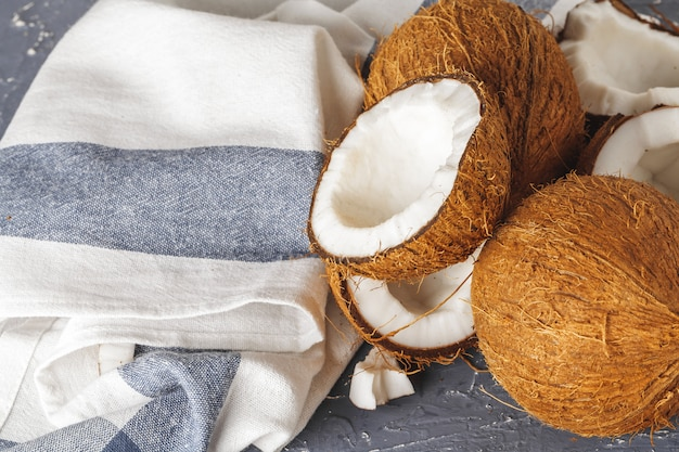 Pile of broken coconuts on ripped grey